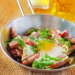 Egg with sausages — Stock Photo