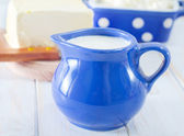 Milk in blue jug — Stock Photo