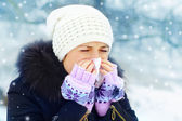 Woman with a cold outdoors — Stock Photo