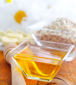 Honey in the glass bowl on the wooden table — Stock Photo