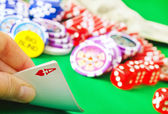Card for poker in the hand and chips — Stock Photo