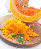 Pumpkin on the wooden board, raw pumpkin — Stock Photo