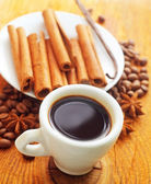 Cinnamon and coffee on the white plate — Stock Photo