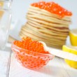 Pancakes with caviar - Stock Photo