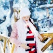 Pregnant womin winter park — Stock Photo #19972501