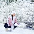 Pregnant woman in snow park — ストック写真