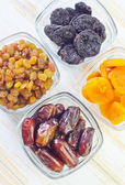 Dried apricots, raisins and dates — Stock Photo