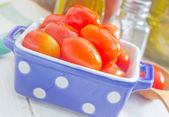 Tomato in cookware — Stock Photo