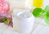 Cosmetic cream in a jar — Stock Photo