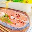 Stock Photo: Salmon on a cutting board