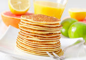 Pancakes with fruit — Stock Photo
