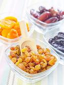 Dried apricots, raisins and dates — Stock Photo
