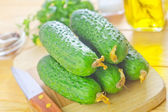 Cucumbers on a wooden board — Stock Photo