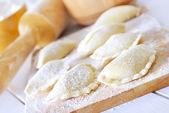 Close-up of raw vareniks, traditional ukrainian food — Stock Photo