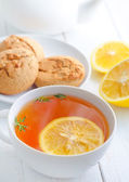 Fresh tea with lemon in the white cup — Stock Photo