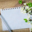 Flowers and note on wooden background — Stock Photo #24171573
