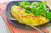 Omelette with salad — Stock Photo