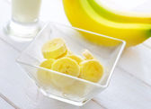 Fresh banana in the glass bowl, banana and milk — Stock Photo