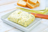 Butter with garlic — Stock Photo