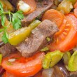 Baked meat with vegetables - Stock Photo