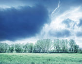 Green field and storm — Stock Photo