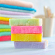 Assortment of soap and towels — Stock Photo