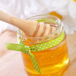Honey with spoon — Stock Photo