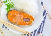 Salmon with rice noodles — Stock Photo