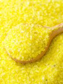 Yellow sea salt for spa, sea salt in wooden spoon — Stock Photo