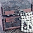 Old wooden chest with perl — Stok fotoğraf