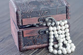 Old wooden chest with perl — Stock Photo