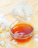 Fresh tea with candy — Stock Photo