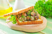 Bread with fried mushrooms — Stock Photo