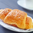 Croissant for breakfast — Stock Photo