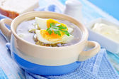 Green soup with eggs — Stock Photo