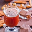 Cocoa with cinnamon and chocolate — Stock Photo