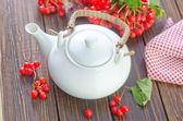 Tea and viburnum — Stock Photo
