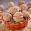 Walnuts in basket — Stock Photo #33102939
