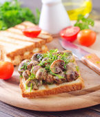 Toasts with fried mushroom — Stock Photo