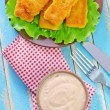 Sauce and fish sticks — Stock Photo