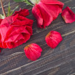 Roses on wooden background — Stok fotoğraf