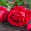 Roses on wooden background — Stock Photo #35955599