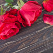 Roses on wooden background — Stock Photo #35955613