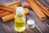 Aroma oil and cinnamon — Stock Photo