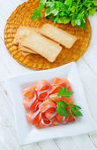 Salmon and toasts — Stock Photo