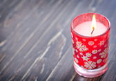 Candle on a wooden table — Stockfoto