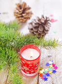Candle and Christmas decoration — Stok fotoğraf