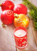 Candle and Christmas decoration — Стоковое фото