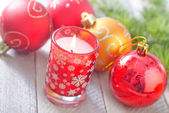 Candle and Christmas decoration — Stock Photo