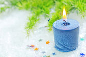 Candle on a table — Stock Photo
